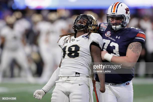 Shaquem Griffin of the UCF Knights celebrates after sacking Jarrett Stidham of the Auburn Tigers in the third quarter during the Chick-fil-A Peach...