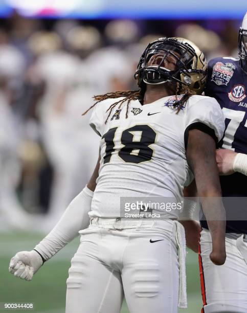 Shaquem Griffin of the UCF Knights celebrates after sacking Jarrett Stidham of the Auburn Tigers in the third quarter during the ChickfilA Peach Bowl...