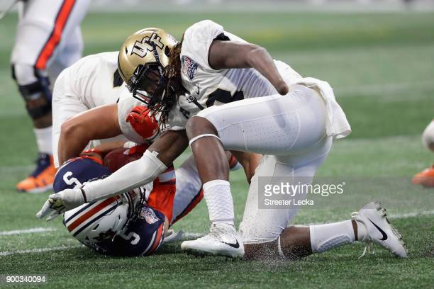 Shaquem Griffin of the UCF Knights sacks Jarrett Stidham of the Auburn Tigers in the third quarter during the ChickfilA Peach Bowl at MercedesBenz...