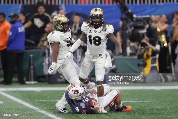 Shaquem Griffin of the UCF Knights steps over Jarrett Stidham of the Auburn Tigers after making a sack in the second quarter during the Chick-fil-A...