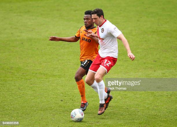 Shaquile Coulthirst of Barnet FC and Ben Tozer of Newport County AFC in action during the Sky Bet League Two match between Barnet FC and Newport...