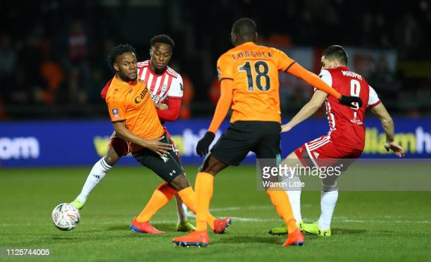 Shaquile Coulthirst of Barnet is tackled by Moses Odubajo of Brentford during the FA Cup Fourth Round match between Barnet and Brentford at The Hive...