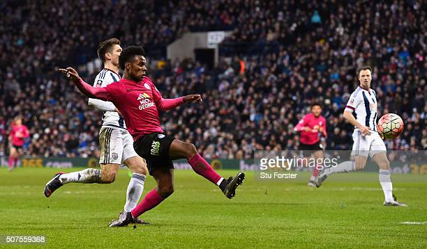 Shaquile Coulthirst of Peterborough United scores his team's first goal during the Emirates FA Cup Fourth Round match between West Bromwich Albion...