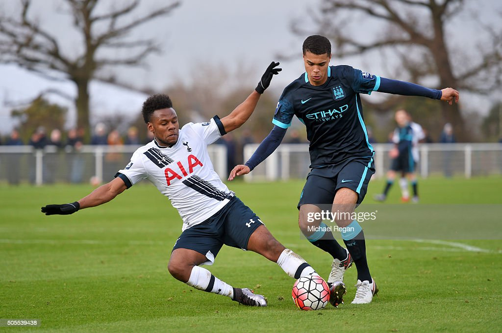 Shaquile Coulthirst of Tottenham Hotspur battles for the ball with Ellis Plummer of Manchester City during the Barclays U21 Premier League match between Tottenham Hotspur and Manchester City at Tottenham Hotspur Training Centre on January 18, 2016 in Enfield, England.