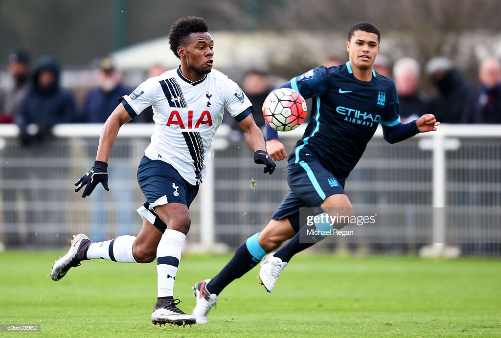 Shaquile Coulthirst of Tottenham Hotspur runs with the ball under pressure from Cameron Humphreys-Grant of Manchester City during the Barclays U21 Premier League match between Tottenham Hotspur and Manchester City at Tottenham Hotspur Training Centre on January 18, 2016 in Enfield, England.