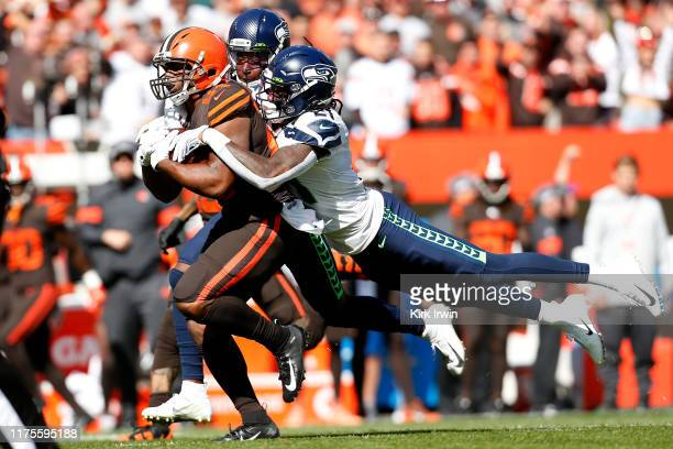 Shaquill Griffin of the Seattle Seahawks and Tre Flowers combine to tackle Nick Chubb of the Cleveland Browns during the first quarter at FirstEnergy...