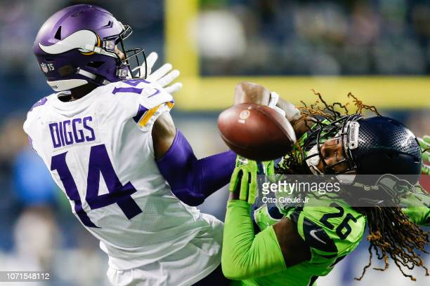 Shaquill Griffin of the Seattle Seahawks breaks up a catch by Stefon Diggs of the Minnesota Vikings in the fourth quarter at CenturyLink Field on...