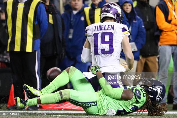 Shaquill Griffin of the Seattle Seahawks lands on the leg of Adam Thielen of the Minnesota Vikings resulting in an injury in the fourth quarter at...