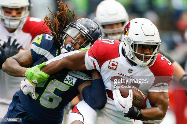Shaquill Griffin of the Seattle Seahawks tackles David Johnson of the Arizona Cardinals to prevent a first down during the 1st qwaurter at...