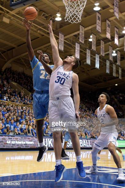 Shaquille Benson of the Southern Jaguars puts up a shot against Antonio Vrankovic of the Duke Blue Devils at Cameron Indoor Stadium on November 17...