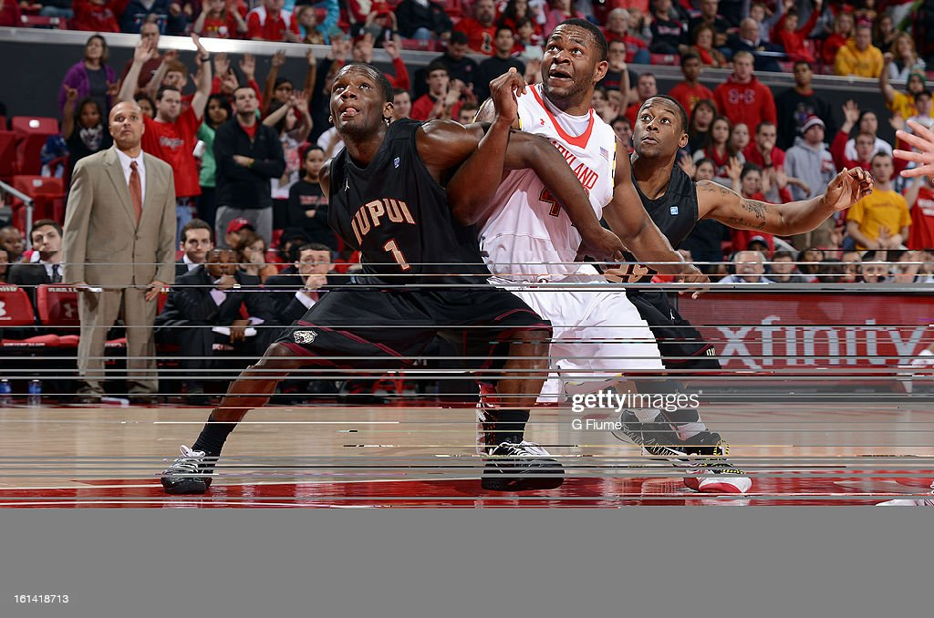 Shaquille Cleare #44 of the Maryland Terrapins boxes out against the Lyonell Gaines #1 and John Hart #25 of IUPUI Jaguars at the Comcast Center on January 1, 2013 in College Park, Maryland.