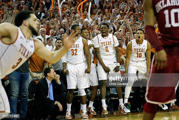 Shaquille Cleare Tevin Mack and Eric Davis Jr #10 of the Texas Longhorns react as they defeat the Oklahoma Sooners at the Frank Erwin Center on...