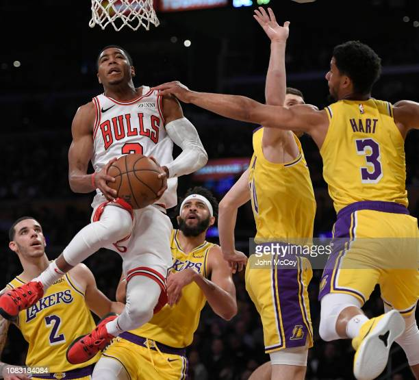 Shaquille Harrison of the Chicago Bulls goes to the hoop past Kyle Kuzma and Josh Hart of the Los Angeles Lakers in the second half at Staples Center...
