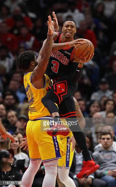 Shaquille Harrison of the Chicago Bulls leaps against Marquese Chriss of the Golden State Warriors to attempt a pass at United Center on December 06...