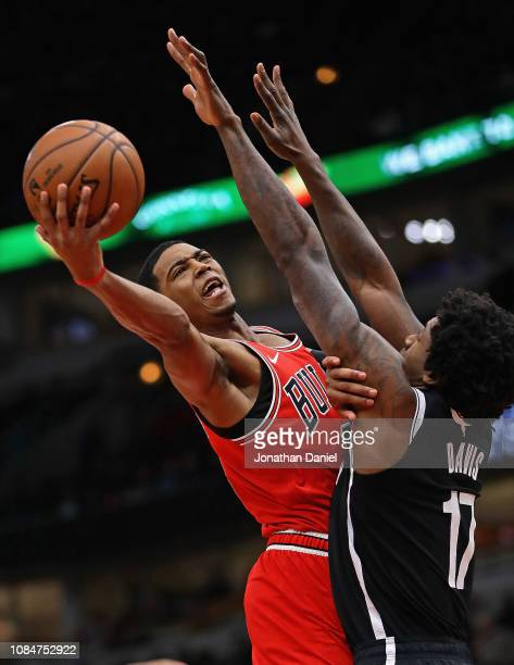 Shaquille Harrison of the Chicago Bulls puts up a shot against Ed Davis of the Brooklyn Nets at the United Center on December 19 2018 in Chicago...
