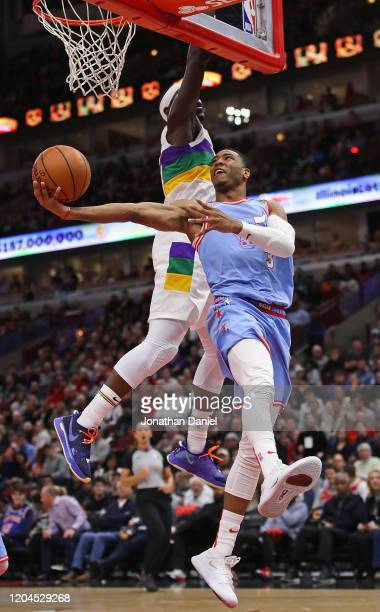 Shaquille Harrison of the Chicago Bulls puts up a shot against Jrue Holiday of the New Orleans Pelicans at the United Center on February 06 2020 in...