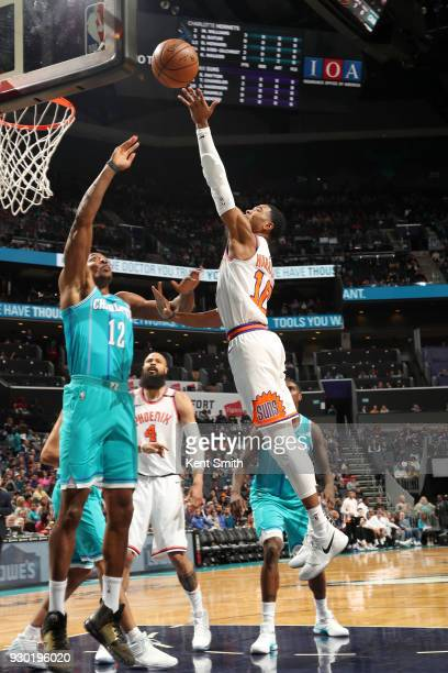 Shaquille Harrison of the Phoenix Suns drives to the basket during the game against the Charlotte Hornets on March 10 2018 at Spectrum Center in...