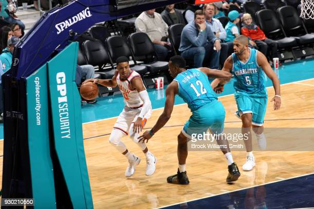 Shaquille Harrison of the Phoenix Suns handles the ball against the Charlotte Hornets on March 10 2018 at Spectrum Center in Charlotte North Carolina...