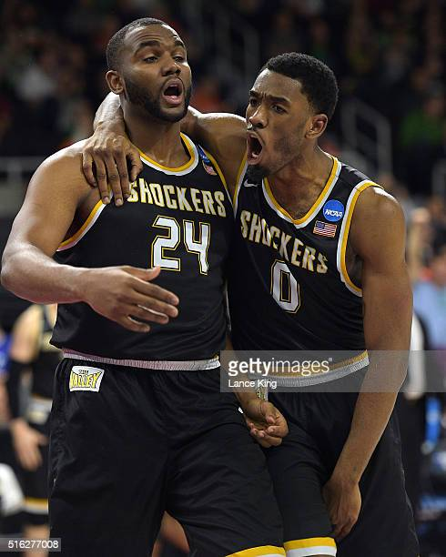 Shaquille Morris and Rashard Kelly of the Wichita State Shockers react following a play against the Arizona Wildcats during the first round of the...