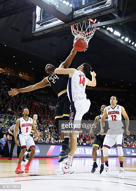 Shaquille Morris of the Wichita State Shockers dunks the ball against Dusan Ristic of the Arizona Wildcats in the second half of their game during...