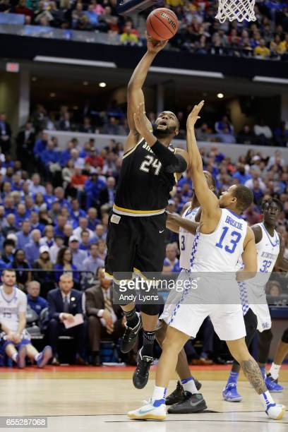 Shaquille Morris of the Wichita State Shockers shoots against Isaiah Briscoe of the Kentucky Wildcats in the first half during the second round of...