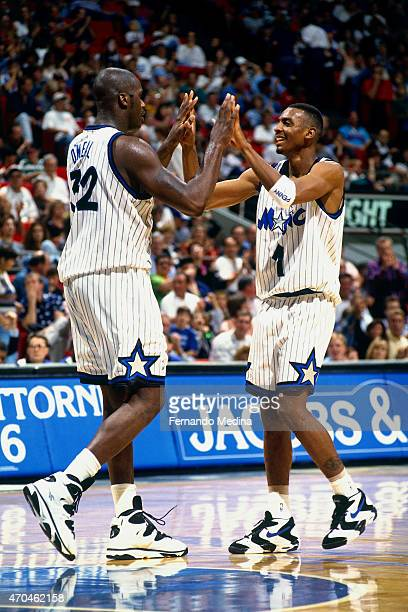 Shaquille O'Neal and Anfernee Hardaway of the Orlando Magic celebrate during a game against the Minnesota Timberwolves on January 6 1995 at the Amway...