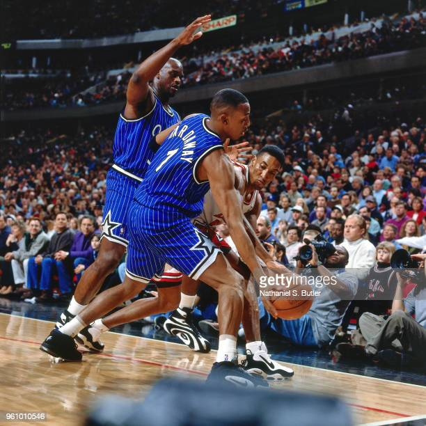 Shaquille O'Neal and Anfernee Hardaway of the Orlando Magic defend Scottie Pippen of the Chicago Bulls on February 25 1996 at the United Center in...