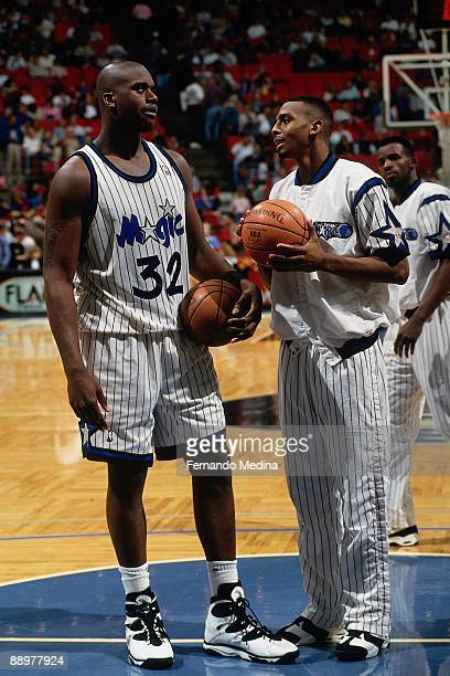 Shaquille O'Neal and Anfernee Hardaway of the Orlando Magic talk on the court prior to their game at the Orlando Arena on January 14 1995 in Orlando...