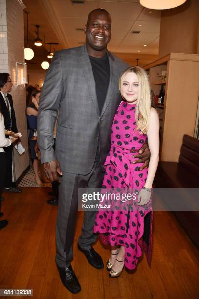 Shaquille O'Neal and Dakota Fanning attend the Turner Upfront 2017 green room at Lugo Cucina Italiana on May 17 2017 in New York City 26617_005