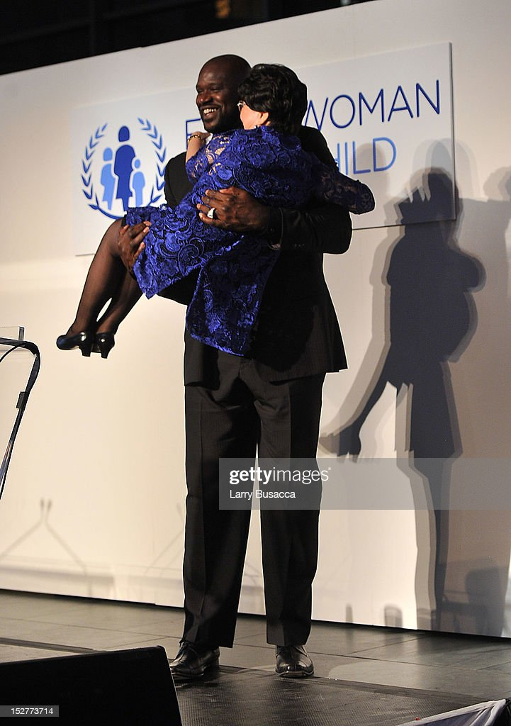 Shaquille O'Neal and Director-General of the World Health Organization Dr Margaret Chan pose onstage at the United Nations Every Woman Every Child Dinner 2012 on September 25, 2012 in New York, United States.