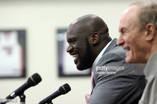 Shaquille O'Neal and his former LSU coach, Dale Brow,n share a laugh with the family, friends and media as O'Neal officially announced his NBA...
