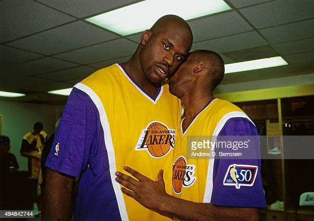 Shaquille O'Neal and Kobe Bryant of the Los Angeles Lakers after the game against the Minnesota Timberwolves in his first regular season game on...