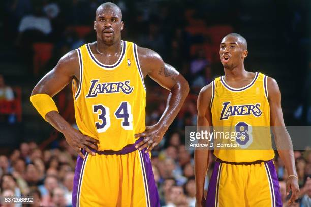 Shaquille O'Neal and Kobe Bryant of the Los Angeles Lakers look on against the Utah Jazz on November 20 1996 at the Great Western Forum in Inglewood...
