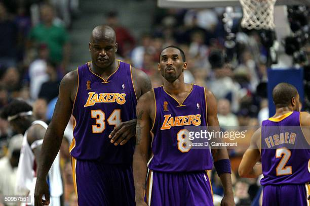 Shaquille O'Neal and Kobe Bryant of the Los Angeles Lakers play against the Detroit Pistons in Game four of the 2004 NBA Finals on June 13 2004 at...