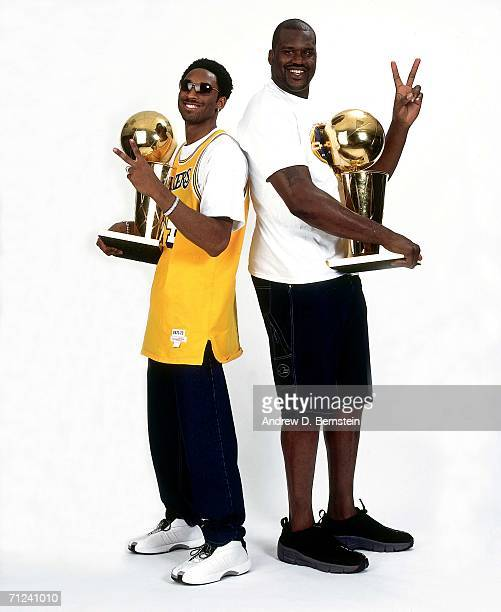Shaquille O'Neal and Kobe Bryant of the Los Angeles Lakers pose for a photo after the Lakers' 2001 NBA Championship parade held June 18 2001 in Los...