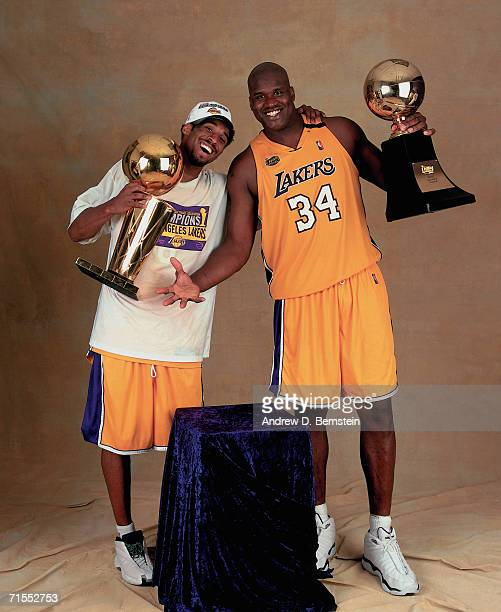 Shaquille O'Neal and Kobe Bryant of the Los Angeles Lakers pose for a photo after winning the NBA Championship on June 19 2000 at the Staples Center...