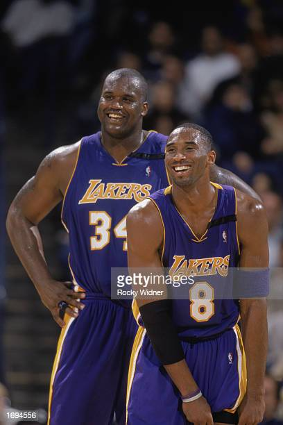 Shaquille O'Neal and Kobe Bryant of the Los Angeles Lakers smile during the NBA game against the Golden State Warriors at The Arena in Oakland on...