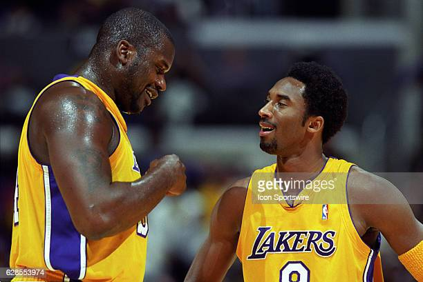 Shaquille O'Neal and Kobe Bryant of the Los Angeles Lakers speak to each other during a National Basketball Association game against the Chicago...