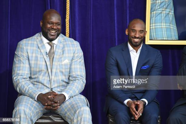Shaquille O'Neal and Kobe Bryant pose for a photo on stage during the Los Angeles Lakers unveiling of the Shaquille O'Neal statue during an event on...