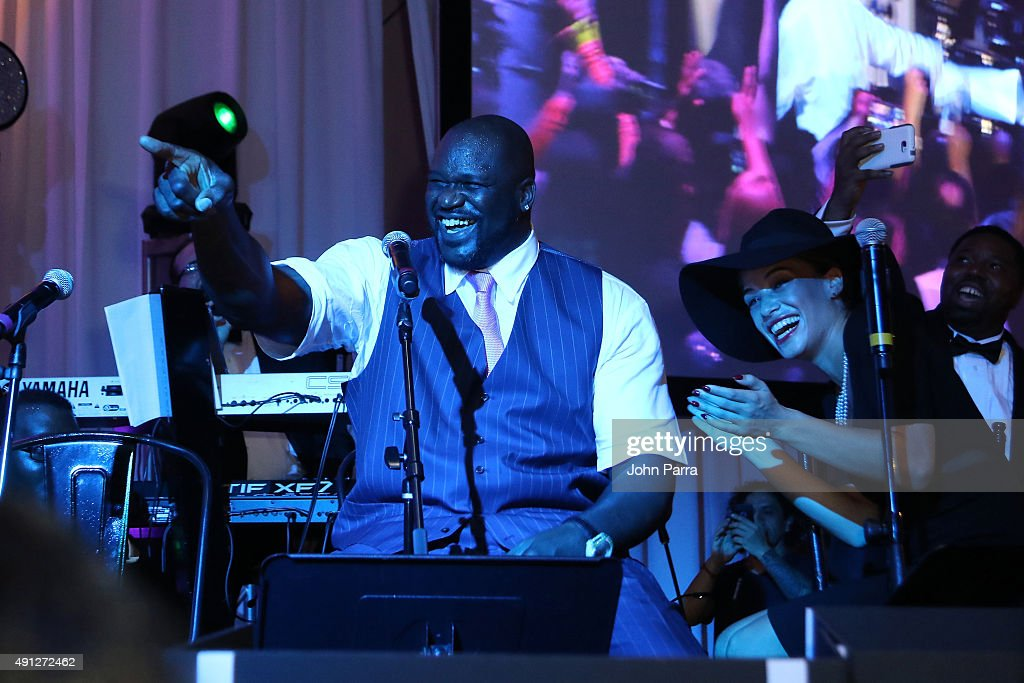 Shaquille O'Neal (L) and Laticia Rolle onstage at Barry University's 75th Anniversary Birthday Bash at Soho Studios on October 3, 2015 in Miami, Florida.