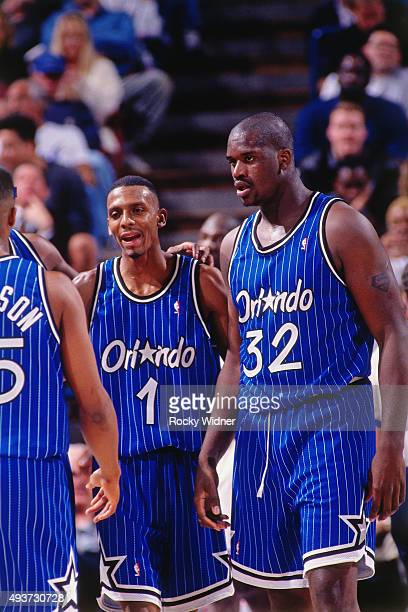 Shaquille O'Neal and Penny Hardaway of the Orlando Magic talk against the Sacramento Kings on March 28 1995 at Arco Arena in Sacramento California...