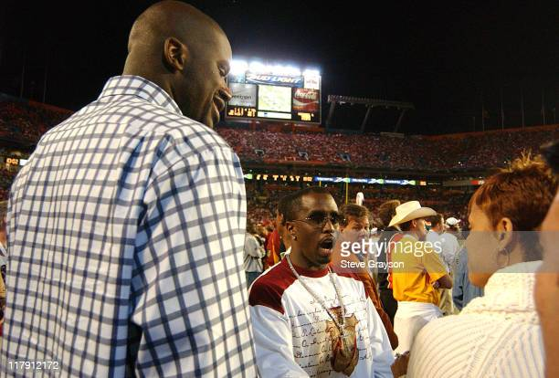 """Shaquille O'Neal and wife Shaunie join Sean """"P. Diddy"""" Combs on the sidelines of the FedEx Orange Bowl in the third quarter at Pro Player Stadium in..."""