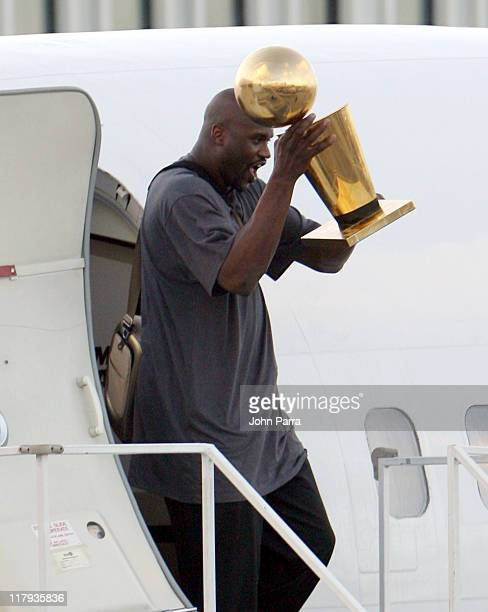 Shaquille O'Neal arriving in Miami holding Larry O'Brien Championship trophy after winning the NBA Championship game the Heat beat the Dallas...