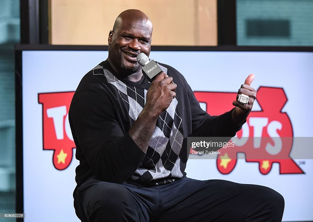 Build Presents Shaquille O'Neal Discussing Toys For Tots : News Photo
