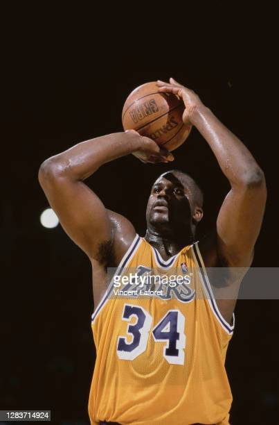 Shaquille O'Neal, Center for the Los Angeles Lakers prepares to shoot a free throw during the NBA Pacific Division basketball game against the Dallas...