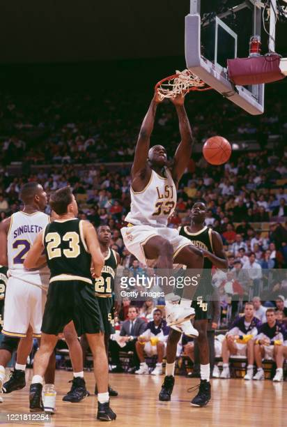 Shaquille O'Neal, Center for the Louisiana State University Fighting Tigers dunks the ball through the hoop during the NCAA Southeastern Conference...