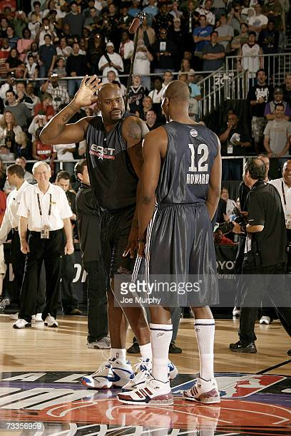 Shaquille O'Neal dances in front of Dwight Howard of the East All-Star Team during the 2007 East All Star Practice at NBA Jam Session Center Court on...