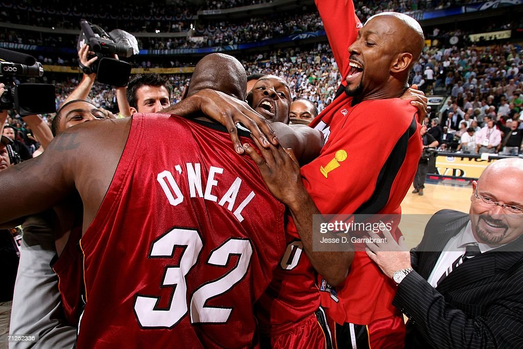 Shaquille O'Neal #32, Gary Payton #20 and Alonzo Mourning #33 of the Miami Heat celebrate winning the NBA Championship after the won 95-92 against the Dallas Mavericks during Game Six of the 2006 NBA Finals June 20, 2006 at American Airlines Center in Dallas, Texas.