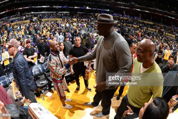 Shaquille O'Neal greets Floyd Mayweather before the Los Angeles Lakers vs Golden State Warriors game/Kobe Bryant jersey retirement ceremony on...