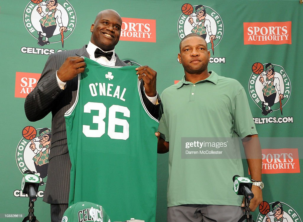 Shaquille O'Neal (L) holds up his new jersey alongside head coach Doc Rivers of the Boston Celtics August 10, 2010 at the Boston Celtic training facility in Waltham, Massachusetts. O'Neal was recently acquired by the Celtics for a two-year 2.8 million dollar contract.